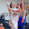 Sandwich's Jimmy Roop (21) goes up for a layup against Genoa-Kingston's Will Franson (right) during a boys varsity basketball game at Sandwich High School on Friday, January 5, 2018. Steven Buyansky - For Shaw Media