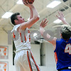 Sandwich's Jimmy Braddish (24) takes a short jumper over Genoa-Kingston's Justin Peters (4) during a boys varsity basketball game at Sandwich High School on Friday, January 5, 2018. Steven Buyansky - For Shaw Media