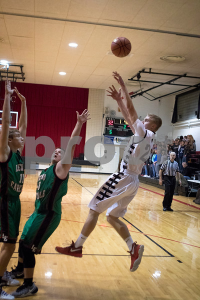 Sam Buckner for Shaw Media.<br /> Kevin Jordal shoots a fade away against Leland-Earlville on Friday January 6, 2017.