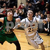 Sam Buckner for Shaw Media.<br /> Nolan Govig spins in front of Brad Seits of Leland-Earlville to get a rebound on Friday January 6, 2017.