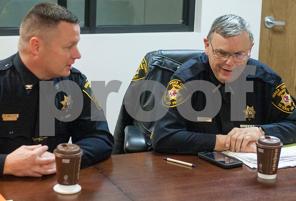 Eric Olson - eolson@shawmedia.com<br /> DeKalb County Sheriffs Office Chief Deputy Andy Sullivan, left, and Sheriff Roger Scott, right, talk during an interview at the Daily Chronicle on Friday, Jan. 6, 2017 in DeKalb.