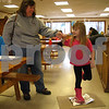 Erin Duffin, 6, of DeKalb makes her own track on aluminum foil with help from her mother, Carol Lee Duffin.