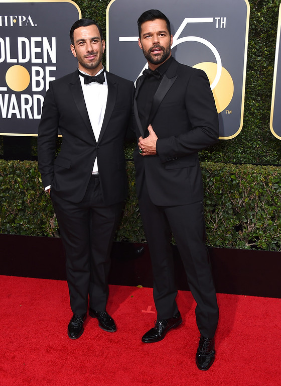 . Jwan Yosef, left, and Ricky Martin arrive at the 75th annual Golden Globe Awards at the Beverly Hilton Hotel on Sunday, Jan. 7, 2018, in Beverly Hills, Calif. (Photo by Jordan Strauss/Invision/AP)