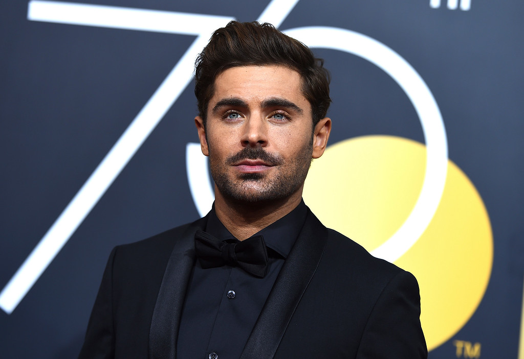 . Zac Efron arrives at the 75th annual Golden Globe Awards at the Beverly Hilton Hotel on Sunday, Jan. 7, 2018, in Beverly Hills, Calif. (Photo by Jordan Strauss/Invision/AP)