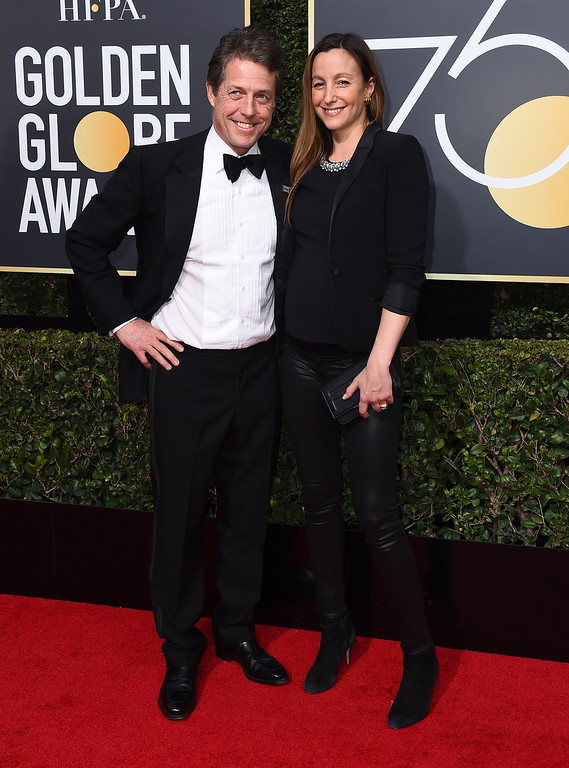 . Hugh Grant, left, and Anna Eberstein arrive at the 75th annual Golden Globe Awards at the Beverly Hilton Hotel on Sunday, Jan. 7, 2018, in Beverly Hills, Calif. (Photo by Jordan Strauss/Invision/AP)