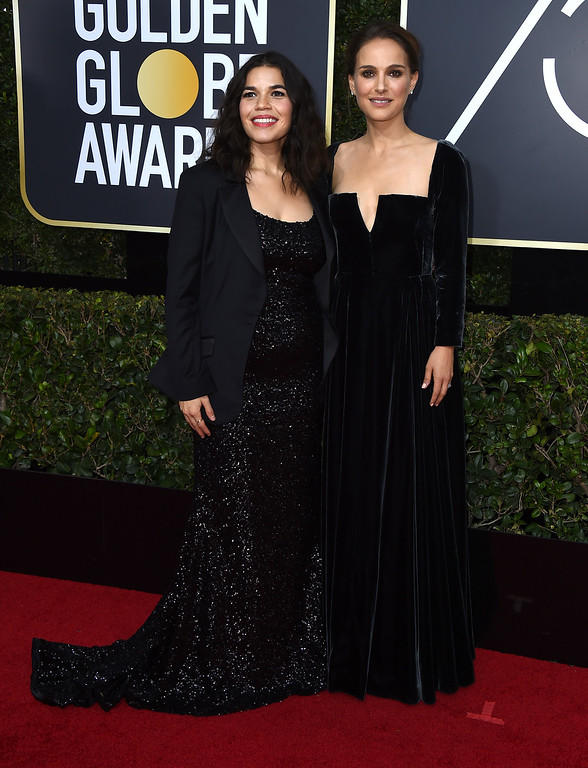 . America Ferrera, left, and Natalie Portman arrive at the 75th annual Golden Globe Awards at the Beverly Hilton Hotel on Sunday, Jan. 7, 2018, in Beverly Hills, Calif. (Photo by Jordan Strauss/Invision/AP)