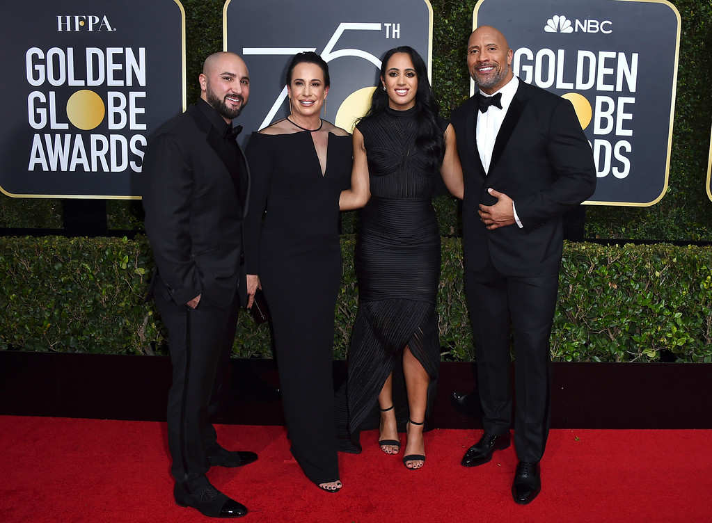 . Dave Rienzi, from left, Dany Garcia, Simone Garcia Johnson and Dwayne Johnson arrive at the 75th annual Golden Globe Awards at the Beverly Hilton Hotel on Sunday, Jan. 7, 2018, in Beverly Hills, Calif. (Photo by Jordan Strauss/Invision/AP)