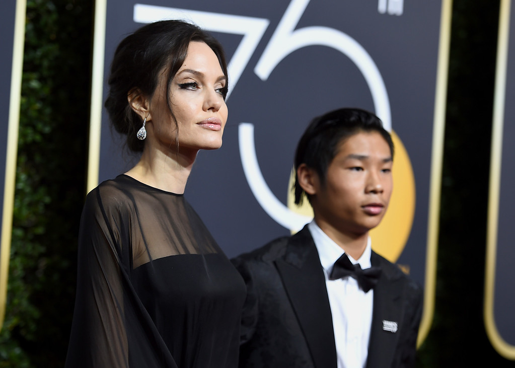 . Angelina Jolie, left, and Pax Jolie-Pitt arrive at the 75th annual Golden Globe Awards at the Beverly Hilton Hotel on Sunday, Jan. 7, 2018, in Beverly Hills, Calif. (Photo by Jordan Strauss/Invision/AP)