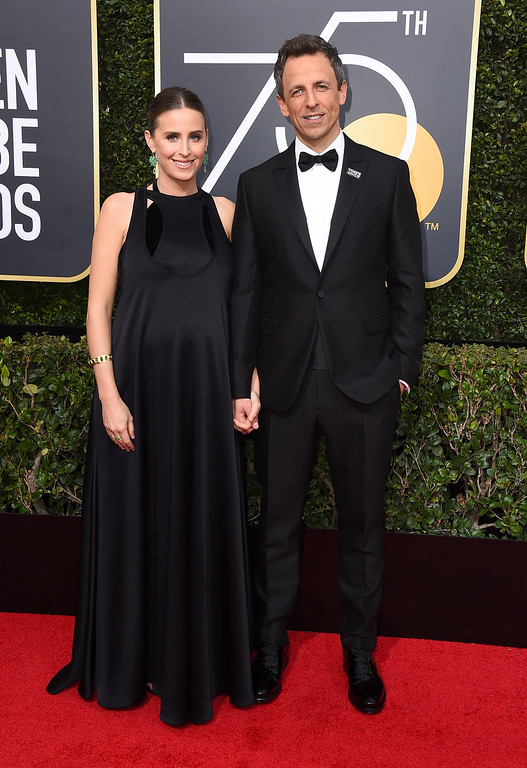 . Alexi Ashe, left, and Seth Meyers arrive at the 75th annual Golden Globe Awards at the Beverly Hilton Hotel on Sunday, Jan. 7, 2018, in Beverly Hills, Calif. (Photo by Jordan Strauss/Invision/AP)