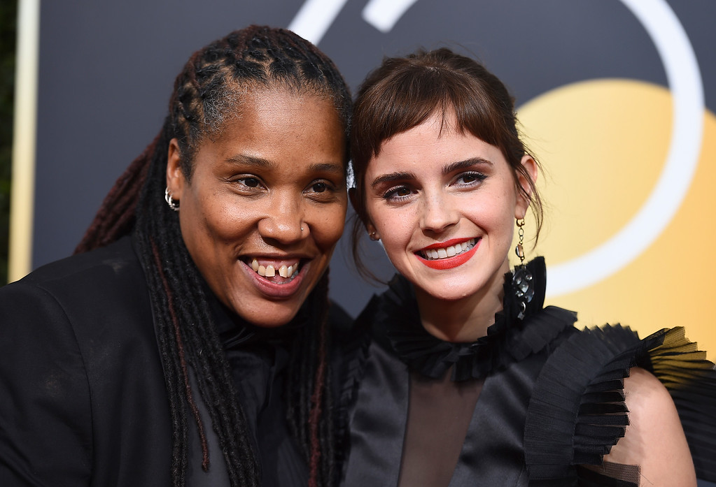 . Marai Larasi, left, and Emma Watson arrive at the 75th annual Golden Globe Awards at the Beverly Hilton Hotel on Sunday, Jan. 7, 2018, in Beverly Hills, Calif. (Photo by Jordan Strauss/Invision/AP)