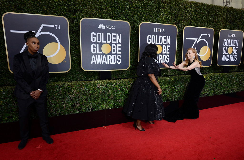 . Lena Waithe, from left, Octavia Spencer and Jessica Chastain arrive at the 75th annual Golden Globe Awards at the Beverly Hilton Hotel on Sunday, Jan. 7, 2018, in Beverly Hills, Calif. (Photo by Jordan Strauss/Invision/AP)