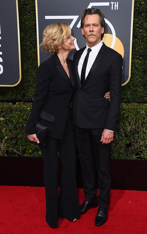. Kyra Sedgwick, left, and Kevin Bacon arrive at the 75th annual Golden Globe Awards at the Beverly Hilton Hotel on Sunday, Jan. 7, 2018, in Beverly Hills, Calif. (Photo by Jordan Strauss/Invision/AP)
