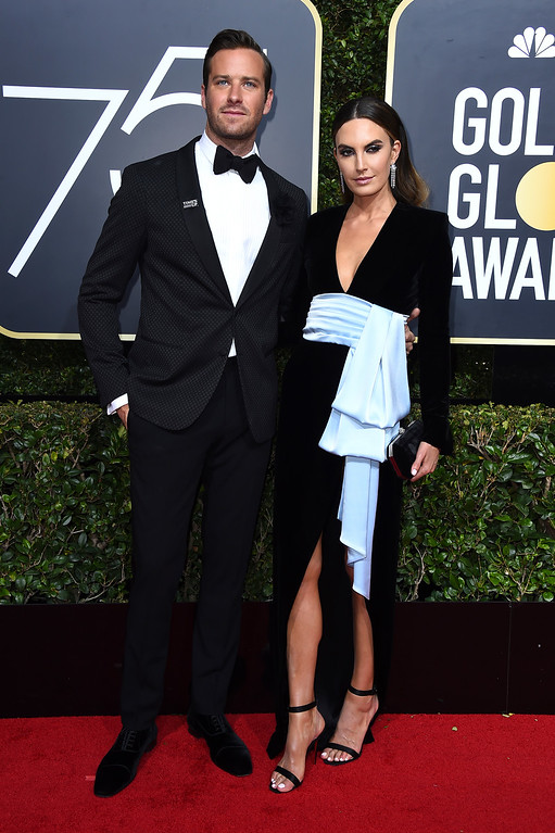 . Armie Hammer, left, and Elizabeth Chambers arrive at the 75th annual Golden Globe Awards at the Beverly Hilton Hotel on Sunday, Jan. 7, 2018, in Beverly Hills, Calif. (Photo by Jordan Strauss/Invision/AP)