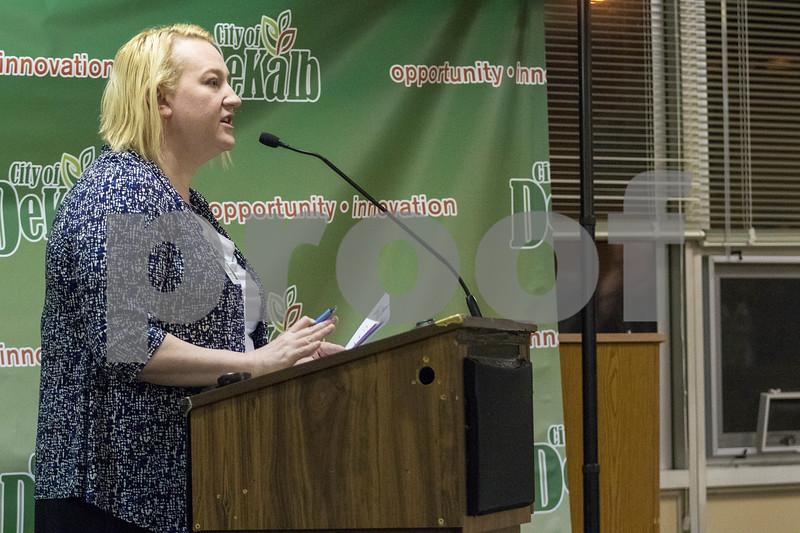 Sam Buckner for Shaw Media.<br /> Molly Talkington reads a report on Monday January 8, 2018 at the City Council meeting.