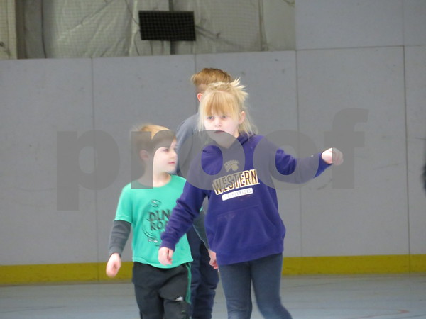 Abby Abigaxre, 6, of Sycamore skates with her brother, Christian, 4, during the open skate part of the winter skate event Saturday at the Kishwaukee YMCA, 2500 Bethany Road, Sycamore.