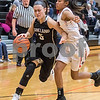 Sam Buckner for Shaw Media.<br /> Hannah Armin dribbles past Dekalb's Sanaa Finner on Tuesday January 9, 2018.