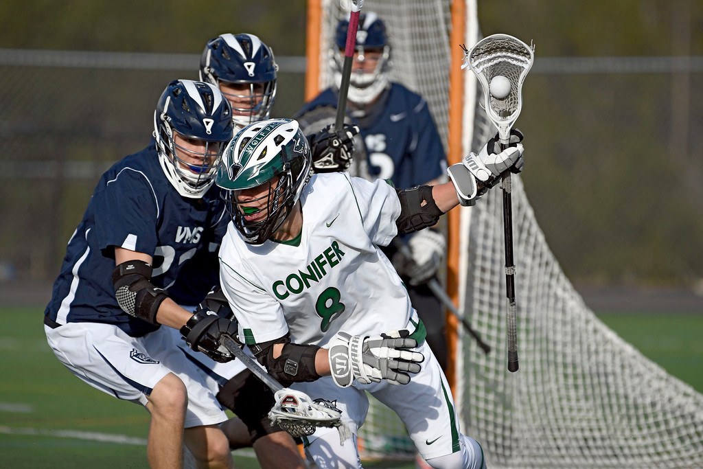 . CONIFER, CO - MAY 10: Conifer Mason Meyer (8) tries to get round Vail Mountain Peter Tice (22) during Class 4A boys lacrosse first round playoffs May 10, 2016 at Conifer highs school. (Photo By John Leyba/The Denver Post)