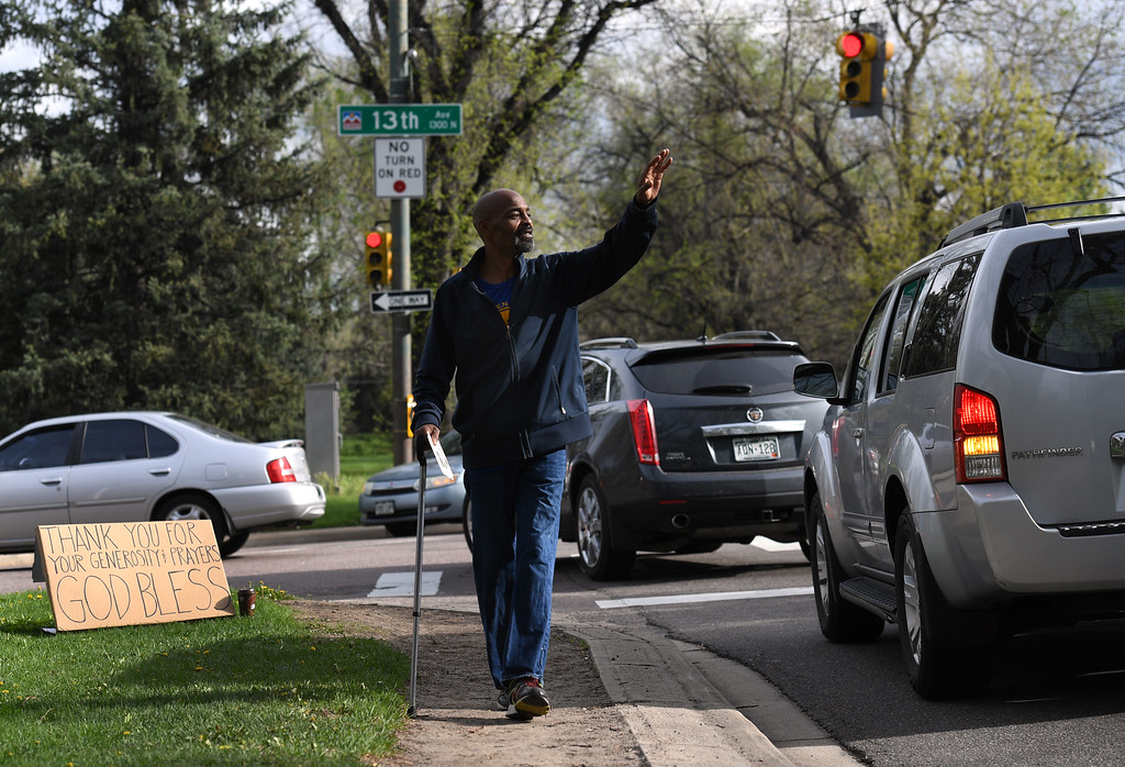 ". DENVER, CO - MAY 10: Cedric McCarty returns to the corner of E. 13th Ave. and Monaco Street Pkwy in Denver on Tuesday, May 10, 2016, to thank the ""angels\"" he says saved his family by raising money which moved them from homelessness and week to week living in a local motel, to having an apartment of their own. (Photo by Kathryn Scott Osler/The Denver Post)"