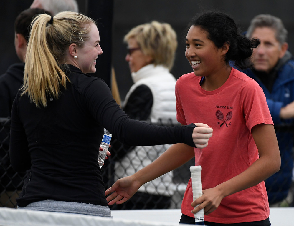 . Seraphin Castelino, Fairview, right, celebrates her Colorado State 5A championship with teammate, #2 singles, Natalie Munson after defeating opponent Ky Ecton, Poudre, at the Gates Tennis Center May 14, 2016. Castelino won defeating Ecton 6-1 in the second set. (Photo by Andy Cross/The Denver Post)