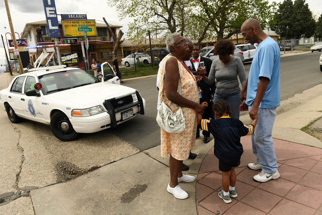 . DENVER, CO - MAY 9:  Claudine McCullough, left, and her grandson Jaden Mitchell, 3, take part in a prayer circle for the people in the neighborhood during an officer involved shooting investigation at Colfax ave between Wabash and Verbena streets on May 9, 2016 in Denver, Colorado. The victim was transported to an area hospital in critical condition. (Photo by Helen H. Richardson/The Denver Post)