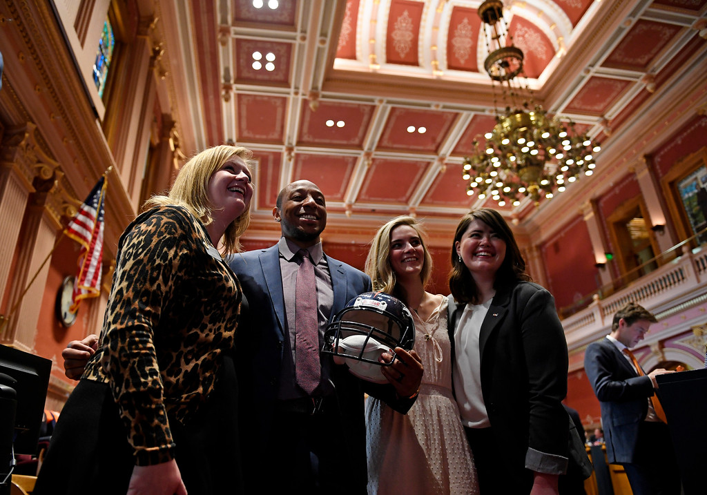 . DENVER, CO - MAY 11:  Senate interns Lori Brown, left, Jenna Carver, second from right, and  Chelsea Nunnenkamp,  right, who work for Majority leader Mark Scheffel, get their photo taken with Denver Broncos Cornerback Chris Harris, second from left, in the Senate Chambers, on the last day of the legislature at the State Capitol on May 11, 2016 in Denver, Colorado.  Both the Colorado House of Representatives and State Senators honored Harris with a Super Bowl 50 tribute for the team\'s world championship and its contributions to the city of Denver. Both the House and the Senate were in session for the last day of the Colorado\'s 70th General Assembly. (Photo by Helen H. Richardson/The Denver Post)