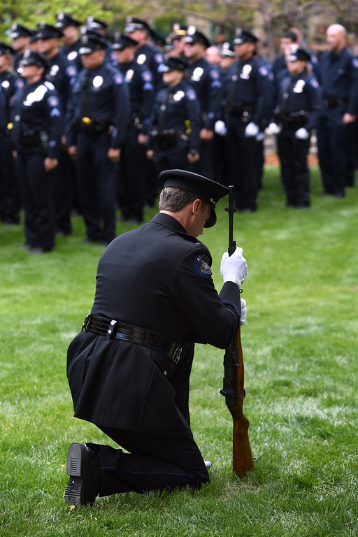 . AURORA, CO - MAY 10: The Honor Guard Rifle Team performs as the Aurora Police Department honors the lives of fallen law enforcement officers in a ceremony at the department\'s Fallen Police Officer Memorial on Tuesday, May 10, 2016. In addition to recognizing Aurora Police officers who died in the line of duty, all officers in Colorado that died in the line of duty since January 2015, were honored.  (Photo by Kathryn Scott Osler/The Denver Post)