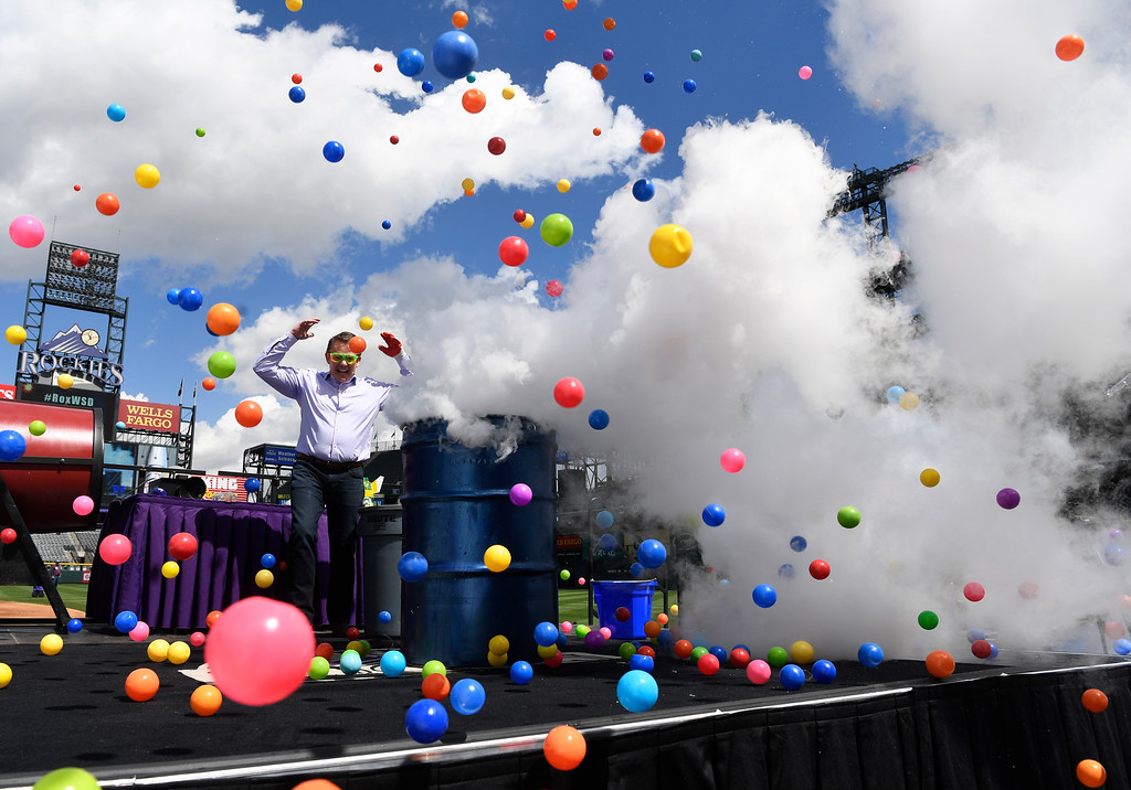 . DENVER, CO - May 11: Steve Spangler, Steve Spangler Science, sends plastic balls up in the air by mixing cool liquid nitrogen with hot water during the annual Weather and Science Day at Coors Field May 11, 2016. Over 10,000 area school children enjoyed the interactive science experiments that incorporated physics, mathematics and meteorology and then were treated to the Colorado Rockies game against the Arizona Diamondbacks. (Photo by Andy Cross/The Denver Post)