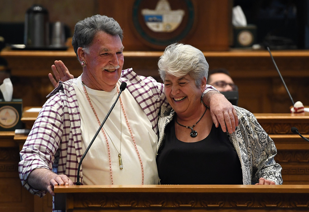 . DENVER, CO - MAY 11:  Representative Don Coram, left, who had dressed up for a skit, gives a parting hug to Representative Lois Court, right, during the annual end of session skits called Hummers on the last day of the legislature at the State Capitol on May 11, 2016 in Denver, Colorado. This was the last day for the House and the Senate of the Colorado\'s 70th General Assembly. Representative Court is term limited and will be running for the Senate. (Photo by Helen H. Richardson/The Denver Post)