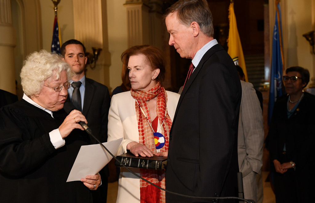 . DENVER, CO - MAY 12:  Donna Lynne, center,  was sworn in as the Lieutenant Governor of Colorado in a ceremony at the state Capitol in Denver on  Thursday, May 12, 2016. Colorado Chief Justice Nancy Rice, left,  swore in Lynne as Governor John Hickenlooper supports the bible.  (Photo by Cyrus McCrimmon/The Denver Post )