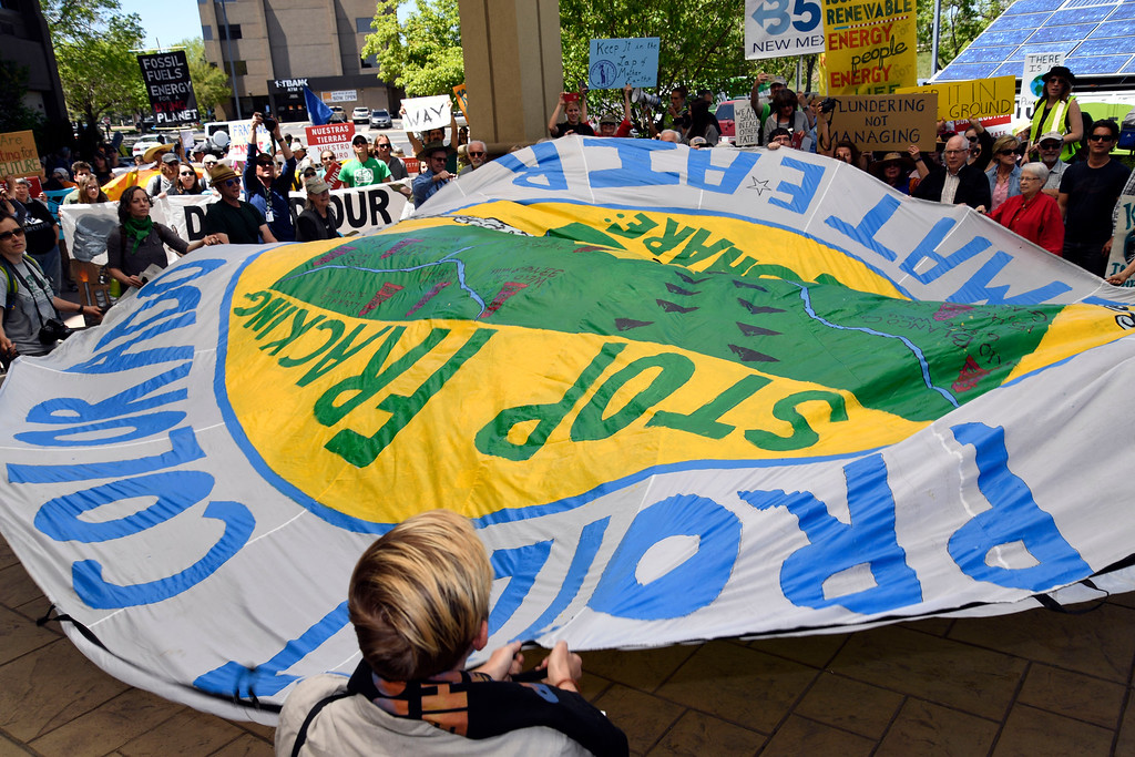 . LAKEWOOD, CO - MAY 12: Hundreds of Colorado community, climate and fracking activists unfurled a parachute as they chant and block the entrance to the Holiday Inn to protest a Bureau of Land Management oil and gas lease auction May 12, 2016 in Lakewood. The group rallied to disrupt the auction which was being held inside the hotel. The groups plan was to demand that public lands be no longer drilled, mined, or fracked. The protest was part of a global week of action focused on citizen action to keep fossil fuels in the ground and promote clean renewable energy, and comes days after the Colorado Supreme Court denied local authority to regulate fracking. (Photo By John Leyba/The Denver Post)