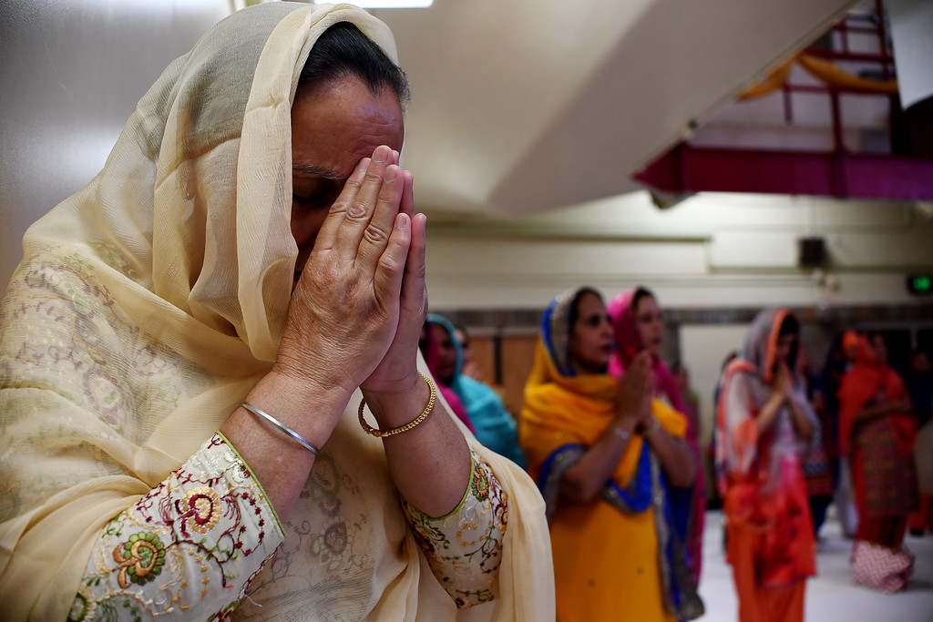 . DENVER, CO - MAY 22: A woman prays during a Sikh religious observance at East High School on Sunday, May 22, 2016. This was Denver\'s first ever Sikh parade. The event was held to celebrate the culture of the growing Sikh population in the area. (Photo by AAron Ontiveroz/The Denver Post)