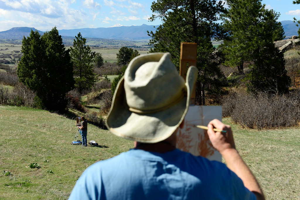 . SEDALIA, CO - MAY 11: Scott Lines sketches out a painting of the landscape while fellow Arts Afield participant Jennifer Reifenberg does the same at the Cherokee Ranch and Castle property on May 11, 2016, in Sedalia, Colorado. Cherokee Ranch and Castle hosts the Arts Afield program, which takes artists of all experience levels onto the ranch property for a day of creation. (Photo by Anya Semenoff/The Denver Post)