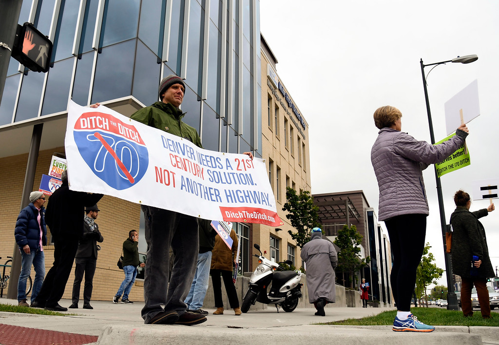 . DENVER, CO - MAY 17: Scott Fiscus of Denver stands outside the United Way offices with his sign to protest the meeting held about the  I-70 expansion plan in NE Denver. Anthony Foxx, United States Secretary of Transportation is in town at a community roundtable discussing Denver\'s Smart City Challenge proposal. (Photo By John Leyba/The Denver Post)