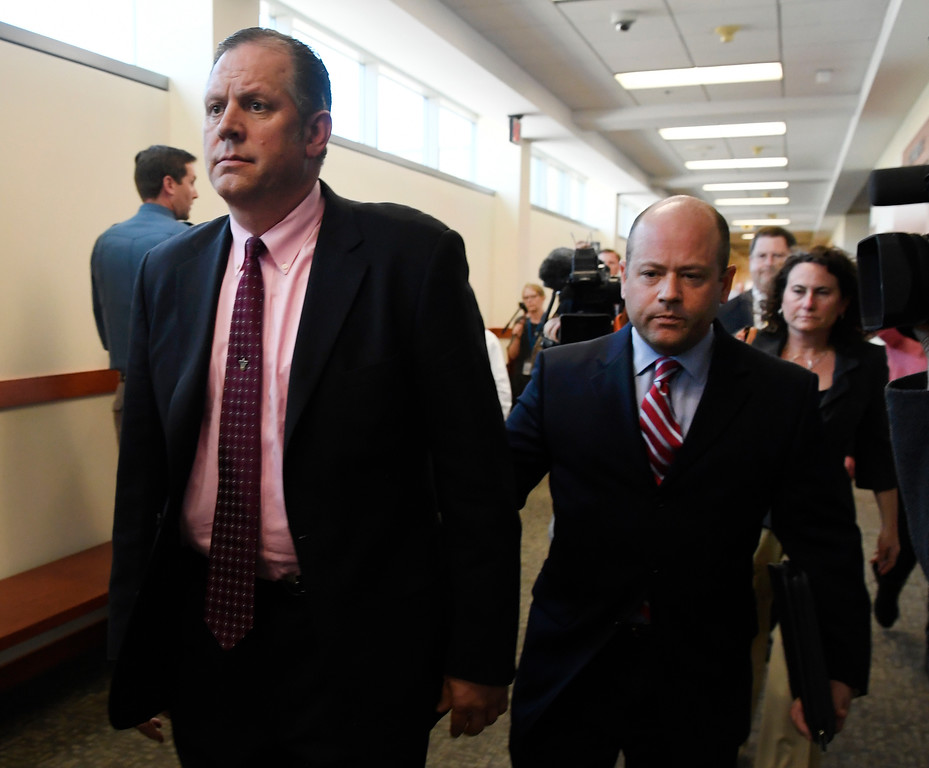 . CASTLE ROCK, CO - May 18: Retired Army Col. Eric Henderson, left, who was accused of hit-and-run, vehicular homicide and drunken driving resulting in the death of Colorado State Trooper Jaimie Jursevics in November 2015, walks out of a Douglas County courtroom after a plea hearing May 18, 2016. (Photo by Andy Cross/The Denver Post)