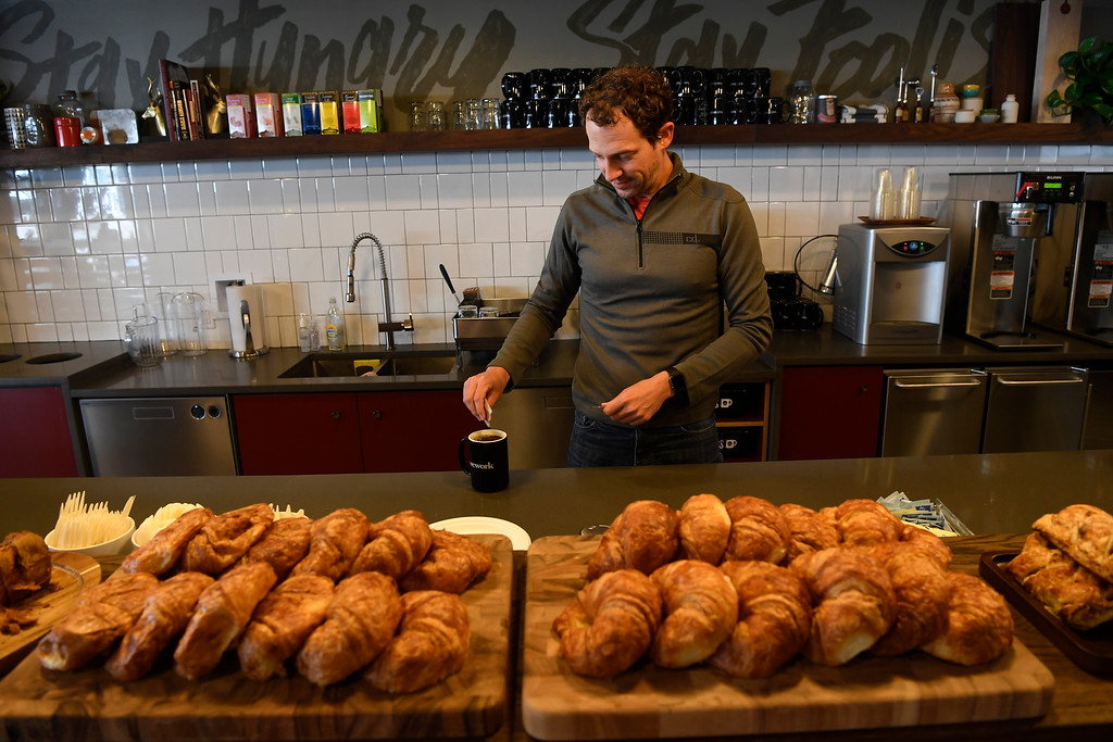 . DENVER, CO - May 18: WeWork Union Station member Rob Auston, with Kloudview.com, a company that is a report card for businesses Saas (Software as a Service) spending,  gets complimentary coffee and croissants in the cafeteria area May 18, 2016. (Photo by Andy Cross/The Denver Post)