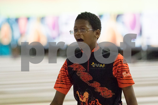 Sam Buckner for Shaw Media.<br /> Michael Rae celebrates a strike on Thursday January 11, 2018 during the NIB12 conference bowling meet.