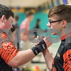 Sam Buckner for Shaw Media.<br /> Logan Frazier shakes hands with Dylan Kersten after Frazier got a strike on Thursday January 11, 2018 during the NIB12 conference bowling meet.