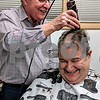 Don Henderson of Spartan Style shaves Dan Gibble's head Thursday as Gibble makes good on his promise to shave his head if the Leaf a Legacy campaign reached its $1 million goal. Gibble, executive director of the Sycamore Park District, said he made the promise last spring, when the campaign was $100,000 short.