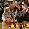 Sycamore's Darnell Coleman (left) tries to secure possession of the ball during the boys basketball game at Sycamore High School, Friday, Jan 12, 2018. (Lisa Fernandez/The Daily Chronicle Correspondent)
