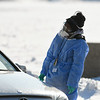 A nurse oversees a drive through Covid test being take in the parking lot at the Convocation Center in DeKalb on Jan. 12th.