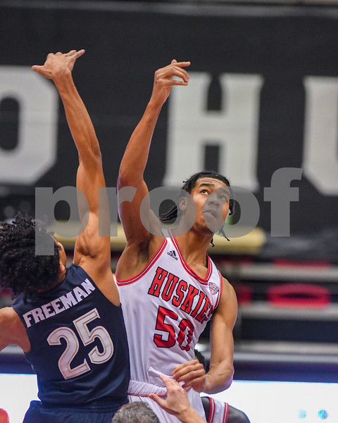 NIU guard Anthony Crump (50) goes up for tip off during Jan 12th game against Akron.