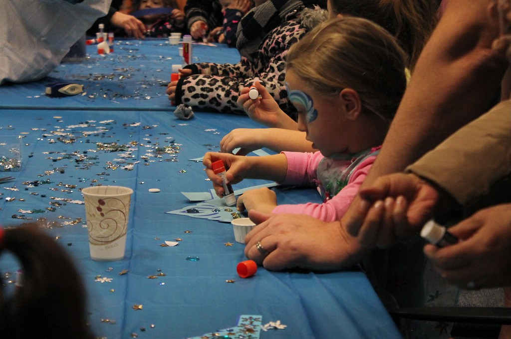 . Maya Hankinson, 4, of Hiram, creates a princess crown during the art workshop at Geauga Parks Frozen Fest. (Kristi Garabrandt/The News-Herald)