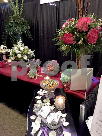 Bouquets and centerpieces made by Flowers by Frank are showcased Sunday at the 16th annual Wedding Expo at Faranda's in DeKalb.