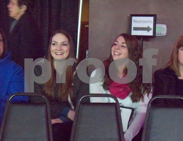 Bride-to-be Brandice Holland (right) and her maid of honor, Megan Wilson, watch the fashion show at the bridal expo.