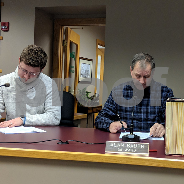First Ward Aldermen David Stouffer (left) and Alan Bauer take notes during Tuesday's Sycamore City Council meeting. The council heard recommendations from the city manager for the budget for fiscal 2019.