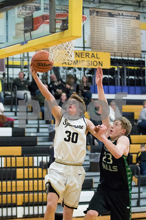 Sam Buckner for Shaw Media.<br /> Austin Schroeder goes up for a layup on Tuesday January 16, 2018 while being guarded by Rock Falls Cade Nailor.