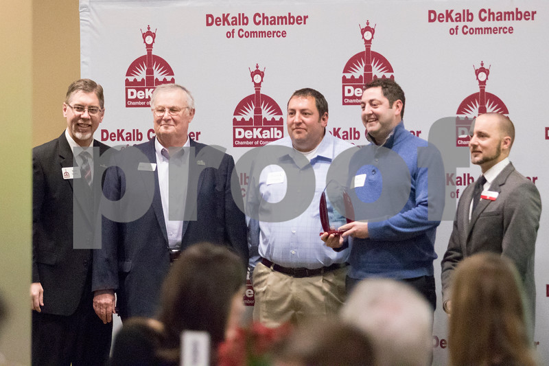 Sam Buckner for Shaw Media.<br /> Ben and Patrick Manning pose for a photo after accepting the DeKalb Chamber of Commerce Hall of Fame award for their grandfather Brad Manning on Thursday January 18, 2018 along with Chamber Executive Director Matt Duffy, DeKalb Mayor Jerry Smith and Chamber Board Chair Brian Oster.
