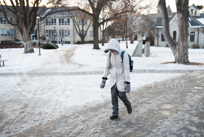 A student trudges to class on a cold, snowy morning on campus at Kansas State University in Manhattan, Kan., on Jan. 16, 2018. (Olivia Bergmeier | Collegian Media Group)