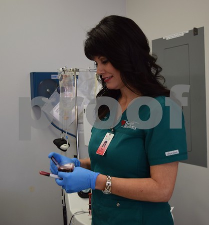 Melisa Ekstorm, team leader at Heartland Blood Centers in DeKalb, prepares vials of blood for testing. Ekstorm said there is a critical need for blood to keep up with the demand from local hospitals.
