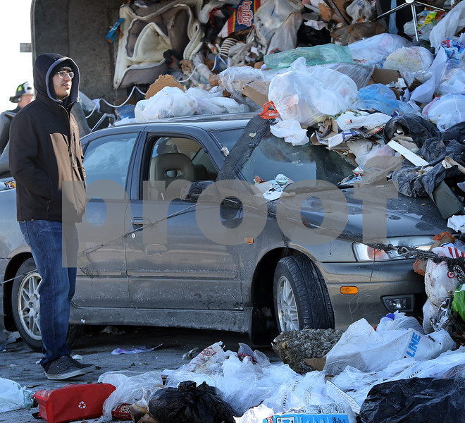 dnews_0118_Garbage_Truck_Crash_COVER